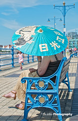 Along the promenade...... (Tim Dobbs) Tags: street portrait beach umbrella bench seaside candid promenade porthcawl coneybeach coastsigma30mmf14