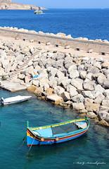 Boats Again (Areti Antonakopoulou) Tags: malta gozo mgarr sea sky rocks