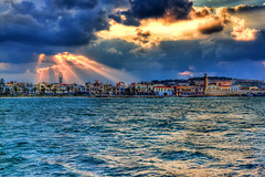 Rethymno (Theophilos) Tags: sea sky lighthouse clouds greece crete sunrays rethymno fortezza
