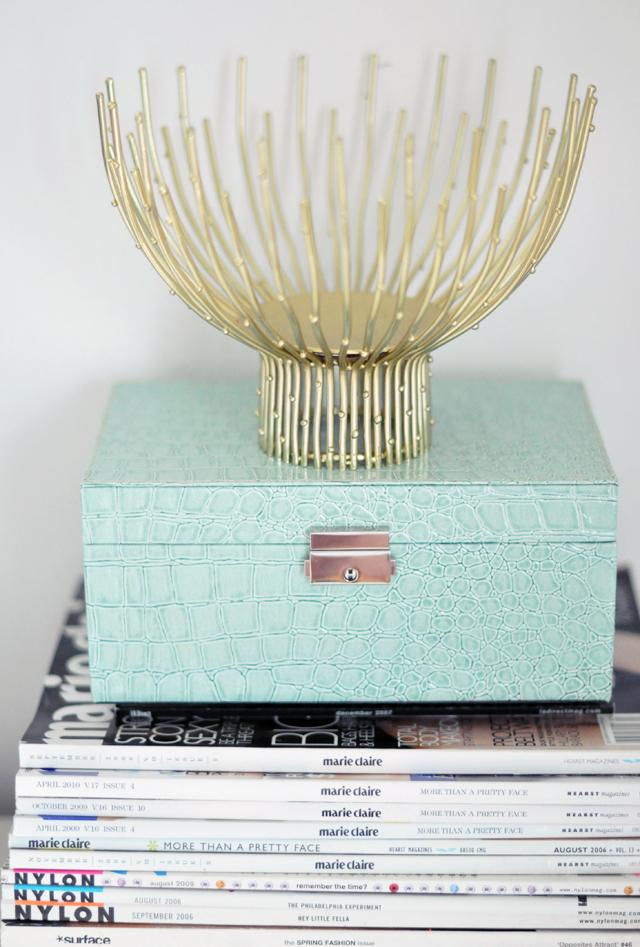 gold branch bowl + crocodile jewelry box + magazines