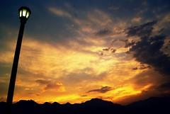 Entre el suelo y el cielo... (Just Like Heaven') Tags: santiago light sunset sky mountains art lamp clouds mexico faro