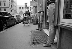 """""""Il manichino ha un'anima, e forse, non lo sa!"""" (Matteo Zannoni) Tags: street bw roma film analog canon eos strada streetphotography delta bn jeans negative epson 24mm dummy ef manikin scarpe gambe marciapiede zingara manichino v330 ef24mm28 streephers"""