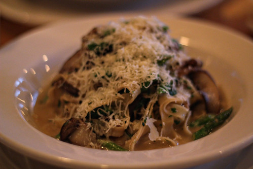 House made fettucini with white wine sauce, portobello mushrooms, asparagus and parmesan