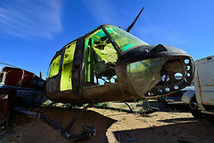 charlie don't surf. 2011. (eyetwist) Tags: longexposure moon west abandoned car night dark photography star chopper nikon desert tripod trails rusty wideangle bulldog cargo led fullmoon vietnam huey helicopter moonlit american workshop mojave moonlight junkyard scrapyard nikkor retired scrap derelict gel nocturne arid hughes strobe startrails mojavedesert helo iroquois rotted deser charliedontsurf uh1 eyetwist npy smellslikevictory airmobile armyaviation d7000 capturenx2 eyetwistkevinballuff napalminthemorning nikond7000 1024mmf3545g paulsjunkyard