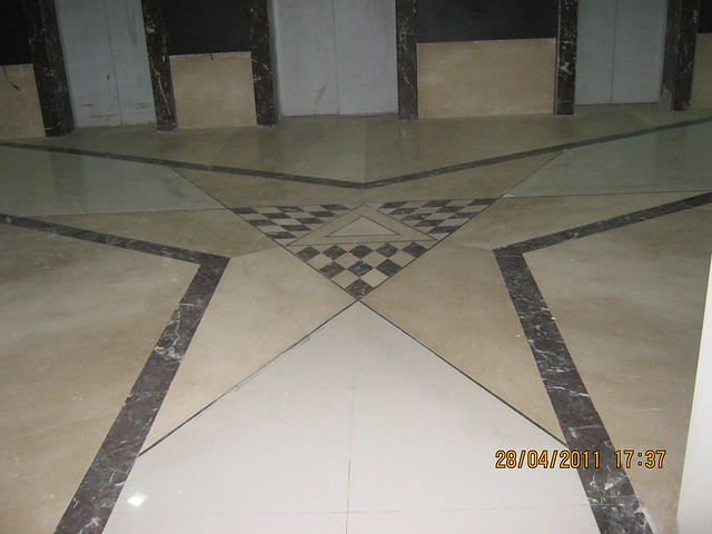 Flooring in elevator lobby of  Sangria Towers at Megapolis Hinjewadi Phase 3, Pune