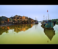 waiting patiently.. (PNike (Prashanth Naik..back after ages)) Tags: blue houses sky orange reflection green water architecture buildings boats nikon village unesco vietnam hoian unescoworldheritage heritagesite merchanttown tradingboats tradingvillage pnike yahoo:yourpictures=reflections