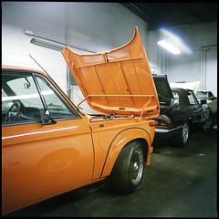 (Ansel Olson) Tags: 2002 orange classic cars 6x6 mamiya tlr film car vintage print automobile fuji garage workshop bmw pro medium format sportscar c330 160s 55mmf45