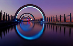 Hypnosis of the Night (kenny barker) Tags: longexposure blue colour reflection art water night fence canal vanishingpoint published purple circles temperature shining falkirkwheel cityart popularphotographymagazine impressedbeauty magicpix concordians fotografaglobal bestcapturesaoi bestofshining lightartmasterpiece stunningphotogpin best4gpin bestphoto4gpinaug2011 vqnight vangoghexcellence
