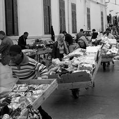 Rush Hour Souk Style (Anthony Cronin) Tags: 6x6 analog square photography all rights souk neopan agfa libya tripoli reserved folders agfaisolette xtol isolette foldingcamera 500x500 streetsphotography fujineopan greensquare solinar libyans agfaisoletteiii film:iso=400 kodakxtol film:brand=fuji formatfolding january2011 anthonycronin filmdev:recipe=5418 developer:brand=kodak developer:name=kodakxtol film:name=fujineopan400 iiicolor skoparmedium camera6x6120filmdevrecipe5418fuji neopankodak xtolfilmbrandfujifilmnamefuji 400filmiso400developerbrandkodakdevelopernamekodak tripolisouk tpastreet tripolioldtown analog© streetphotographyagfa photangoirl