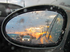 Rear-View Sunset (tim.perdue) Tags: road street columbus sunset ohio red sky orange sun storm reflection window water colors car rain yellow clouds mirror view traffic sundown cloudy rear headlights raindrops