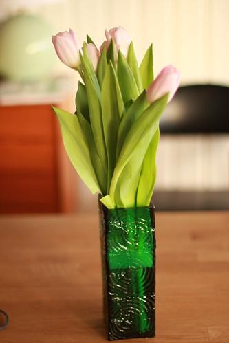 Pink tulips in vintage vase