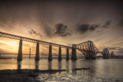 Forth Bridge at Sunset April 12 2011 (Grant_R) Tags: bridge sunset sea reflection river scotland edinburgh hdr firthofforth forthbridge southqueensferry forthroadbridge forthbridges forthrailbridge railbridge roadbridge grantr