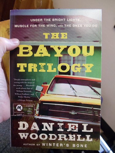 BAYOU TRILOGY by by Daniel Woodrell
