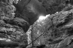 Natural Bridge Sunflare (jball359) Tags: statepark blackandwhite bw canon outdoors hiking naturalbridge arkansas hdr xsi circularpolarizer sunflare petitjean promaster photomatix 1740mmf4lusm pse9 photoshopelements9 sevenhollowsgrotto