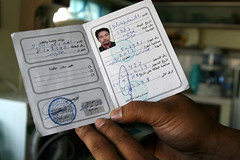 Former Libyan OFW Exequel Masucal displays his green card from Libya. CREDIT: Kara Santos/IPS (IPS Inter Press Service) Tags: poverty africa work israel democracy aljazeera media unitedstates northafrica tunisia refugees sudan flames suicide protest egypt middleeast jordan cairo aid hunger arab exploitation unitednations labour yemen migration humanrights deathpenalty desperation development regime unemployment corruption diplomacy asiapacific civilsociety empower internationalpolitics dissidents entrenched pressfreedom tahrirsquare fairelections wikileaks globalaffairs southsouthcooperation developingeconomy economicfreedom mohamedbouazizi