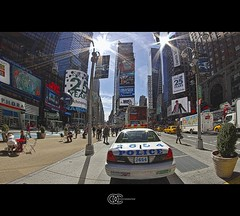 Time Square 8 (OC Photographie) Tags: new york usa sun reflection car america canon square soleil pub cops manhattan united north police voiture fisheye reflet times states publicit hdr nord unis advertise amrique etats