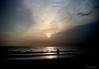 Looking at the sun (aroon_kalandy) Tags: light sunset sun india beach nature beautiful beauty clouds creativity photography lights evening asia photographer adobephotoshop artistic sony awesome kerala impressions concept lovely majestic calicut kozhikode beautifulshot anawesomeshot sonydslra200 malayalikkoottam aroonkalandy abcvisualized