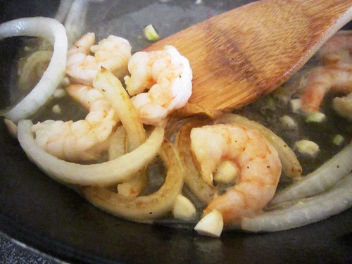 Sauteing shrimp and onion, take one