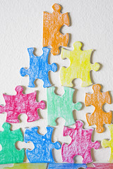 Pyramid of Coloful Jigsaw Pieces (Alex Bramwell) Tags: white inspiration color idea team colorful thought different pyramid diversity puzzle pile thinking highkey jigsaw conceptual piece metaphor answer teamwork varied