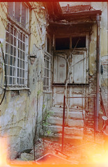 house (OverdeaR [offline 'til July]) Tags: door house abandoned film broken stairs 35mm ruins factory scan lightleak negative aid f2 belgrade fe expired grad accidental beograd solaris stari ajs c41 f20 ferrania majka 352 fg100 nikkoro dorol 100ei scannikon dorol ajsness