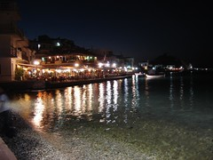 SAMOS BY NIGHT (dimitra_milaiou) Tags: life blue shadow sea summer sky moon white black beach water colors lines architecture night port swimming reflections dark landscape boats island greek lights boat sand europe ship village view sony hellas visit tourist greece moonlight summertime parallel emotions ports ouzo samos dimitra hellenic dscp93a seaways   aigaio ouzaki  milaiou