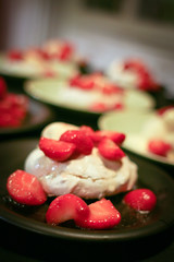 Pistachio pavlova with strawberries and ice cream
