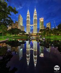 The Jewels | Kuala Lumpur City Centre (kenneth chin) Tags: verticalpanorama blue wilayahpersekutuan architecture tasiksimfoni petronastwintower cityscape digitalblending nikon d810 nikkor1424 yahoo google malaysia kualalumpur klcc city park reflection