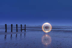 OFNI (Stoff74) Tags: uk light sea england moon lightpainting art beach wool ball painting person photography graffiti pier model photographie lumire steel flash feel perspective banksy orb playa sparklers huts hut lumiere montage eastbourne hastings orbe sparkler orbs plage boule graffitis steelwool stoff benheine orbes stoff74