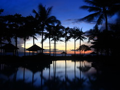 Sunrise  Lagoon (A Sutanto) Tags: blue trees vacation sky bali holiday reflection silhouette indonesia dawn hotel asia lagoon palm resort hour conrad moning