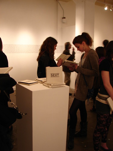 People reading/ SEXT book display