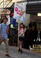 Job Satisfaction (Aaron Webb) Tags: girl sign japan tokyo calendar shibuya harajuku 日本 東京 渋谷 advertisment 原宿 takeshitastreet 渋谷区 japanday9 竹下通り