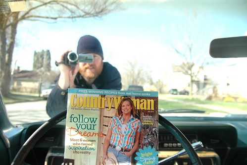 cruisin' in the galaxie while readin' country woman and being filmed.