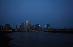 Moonlit Docklands (TheFella) Tags: uk greatbritain blue england urban moon slr london water thames digital canon river eos lights photo twilight europe cityscape unitedkingdom dusk capital photograph processing gb getty docklands bluehour dslr canarywharf financial riverthames wapping limehouse skyscapers postprocessing 500d