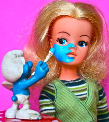 ''TRUST ME YOU WILL LOOK MUCH BETER THIS WAY'' (toypincher) Tags: blue vintage toy doll artist painter smurf collectable pedigree sindy