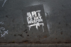 Cheaper than the real thing (Little Big Joe) Tags: street usa streetart newyork art graffiti stencil war gun pavement rifle sidewalk weapon d700