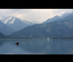 In the mountains (Iam Marjon Bleeker) Tags: lake snow mountains see boat tirol oostenrijk fisherman meer sailing zellamsee sailship
