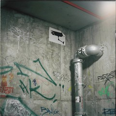 Empty Space: I (Brendan_Timmons) Tags: camera 120 6x6 tlr film concrete graffiti sticker industrial pipes security yashicamat yashinon 80mmf35 kodakektacolorpro160