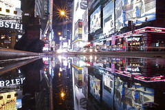 lunar system (maybemaq) Tags: street city longexposure blue urban music usa holiday newyork colour reflection sign america puddle liberty lights mirror us vanishingpoint neon commerce colours cross traffic unitedstates geometry manhattan board ad broadway double symmetry advertisement musical lamppost commercial timessquare signage electricity lobster crossroad signboard economy lunar aftertherain recent waterreflection lightstream maybemaq the4elements colorphotoaward lunarsystem