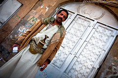 portrait of a man with his Jambiya () in the old city Sana'a-Yemen-- (anthony pappone photography) Tags: world pictures travel people digital canon lens photography photo republic foto image picture culture unesco arabia yemen fotografia sanaa ramadan reportage photograher sejima suk arabo yemeni phototravel yaman arabie arabiafelix arabieheureuse  arabianpeninsula        alyaman yemenpicture yemenpictures eos5dmarkii