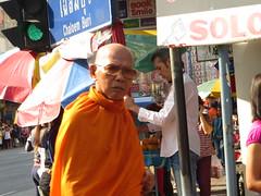 Grumpy monk - Bangkok, Thailand (ashabot) Tags: people thailand seasia cities monks streetscenes buddhists
