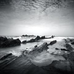 Jagged (Hengki Koentjoro) Tags: ocean sea sky white black beach water rocks long exposure waves surreal shore ethereal
