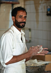 The Baker (Sami T (currently traveling)) Tags: canon souk oman 85 40d muttrahsouq gpp2011
