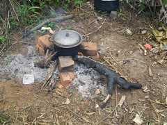 Beans are boiled over an open fire for lunch