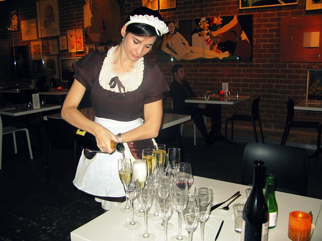 Royal/T Maid pouring champagne by Caroline on Crack
