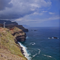 Madeira: North Coast (Mr.Enjoy) Tags: blue cliff west green beach weather landscape island islands coast scenery energy wind farm north windmills cliffs madeira rugged renewable turbines islets costline canial vertorama