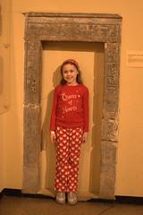 Megan posing in a doorframe