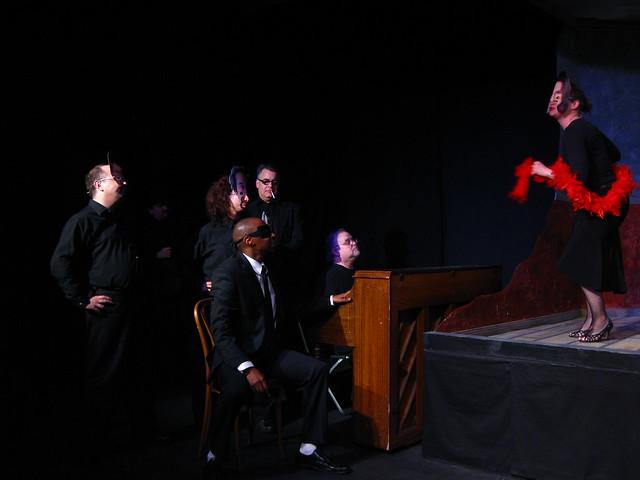 Song and dance. (L-R: Joseph Beck, Adina Valerio, Victor Isaac, Pat Towne, Richard Levinson & CJ Merriman)
