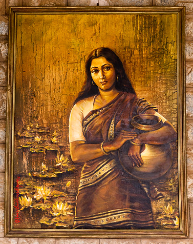 Golden painting of woman with pot