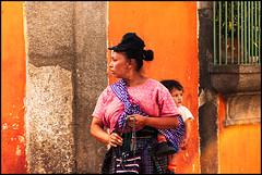 Woman and Child, Antigua, Guatemala (szeke) Tags: 2005 travel people orange woman child guatemala antigua streetvendor nikcolorefex