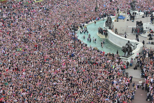 Crowds gather outside Buckingham Palace by The British Monarchy